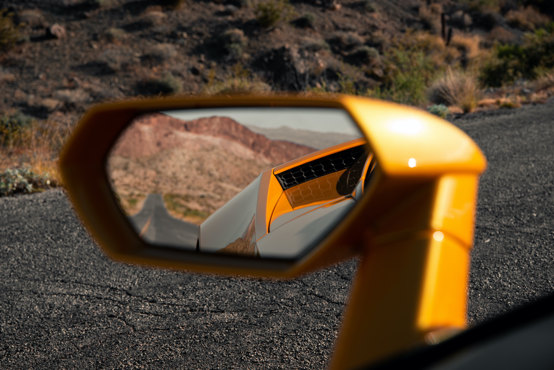 Empty Road Visible in Sports Car Mirror