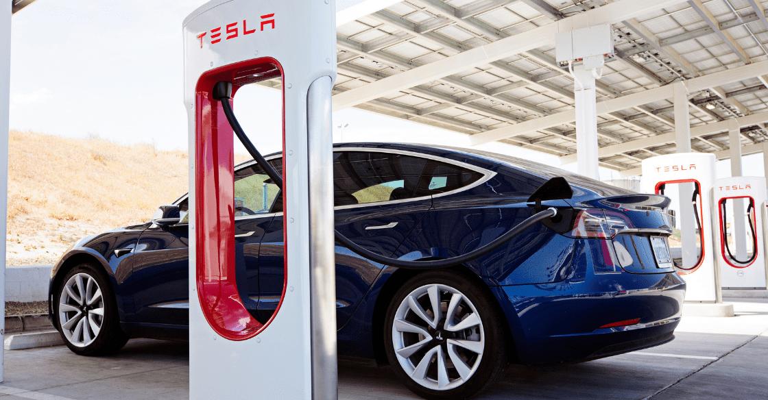 A Tesla rental at a charging station.